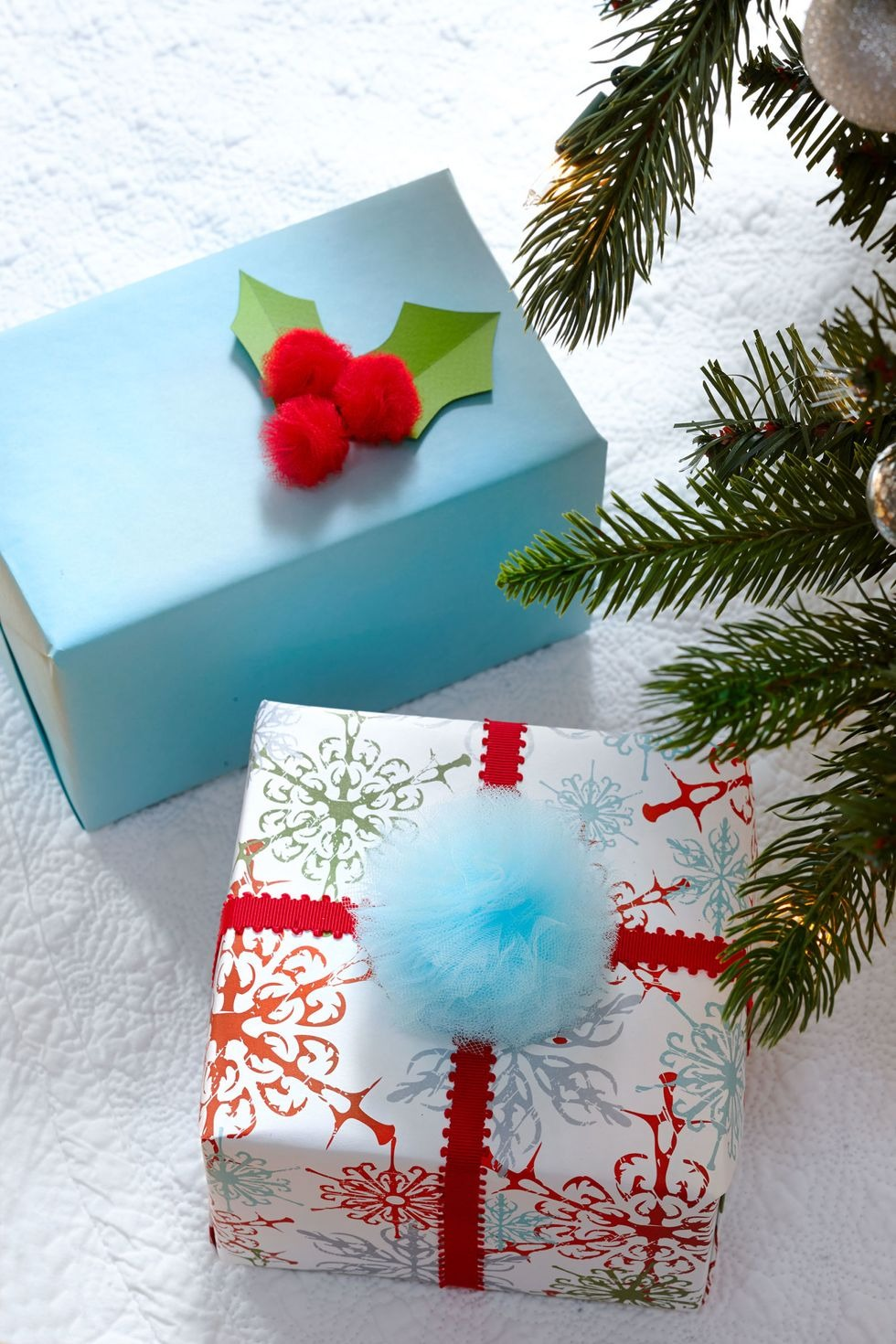 Two Christmas gifts with fluffy tulle toppers