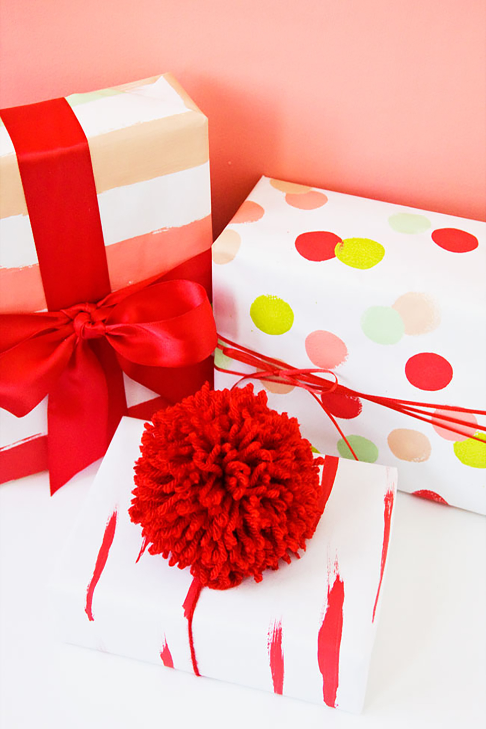 Red tulle pom pom toppers on Christmas gifts