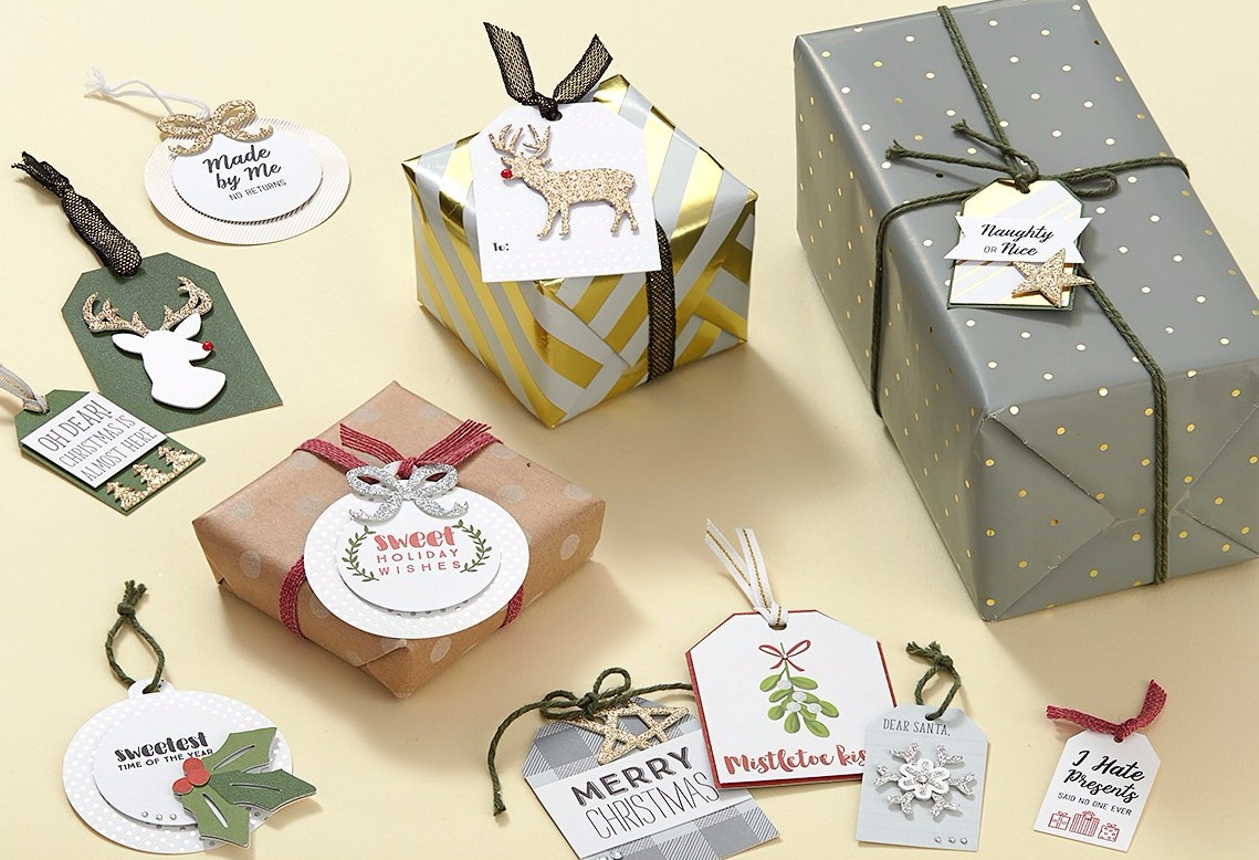 Christmas gifts with gift tags on yellow backdrop