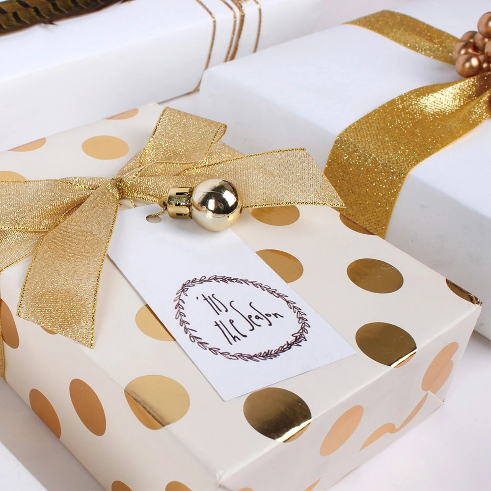 Gold polka dot Christmas gift with gold ribbon and bell